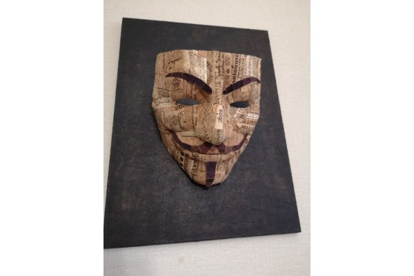 Installation-picture on the wall, Guy Fawkes mask.