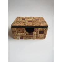 Casket, card holder or calculator made of wood and cork mosaic.