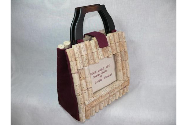 Handmade wine cork bag with embroidered text.
