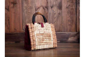 Cork bag with black wooden handles.